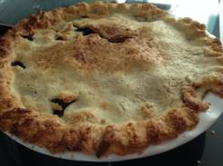 Finished baking! Filling bubbling up out of the steam vents and crust a nice, goldy color. Perfecto!